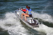 Two Young Women Riding aSilver Jet Ski
