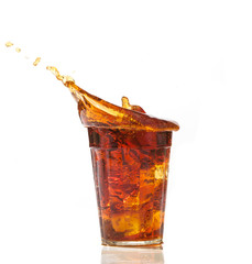 cola glass and cola splashing