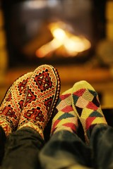 Young romantic couple relax on sofa in front of fireplace at hom