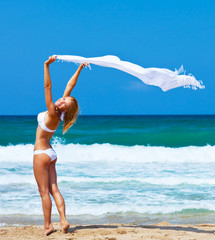 Dancing happy girl on the beach