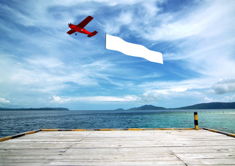 Airplane banner Template with tropical beach background