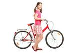 Full length portrait a girl holding a bike