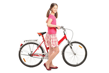 Full length portrait a girl holding a bike
