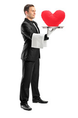 Waiter holding a tray with a red heart shape on it