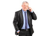 Portrait of a mature businessman talking on a phone