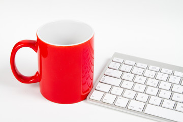 isolated red mug and keyboard