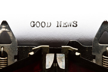 typewriter with text good news