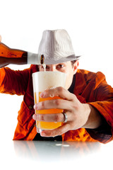 A man pouring beer into pint