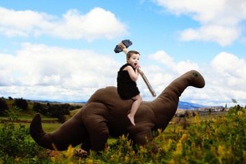 Cave-boy on dinosaur in dreamland