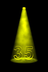 Number 35 illuminated with yellow spotlight