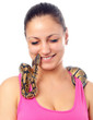 Cute smiling teenage girl playing with small pet python