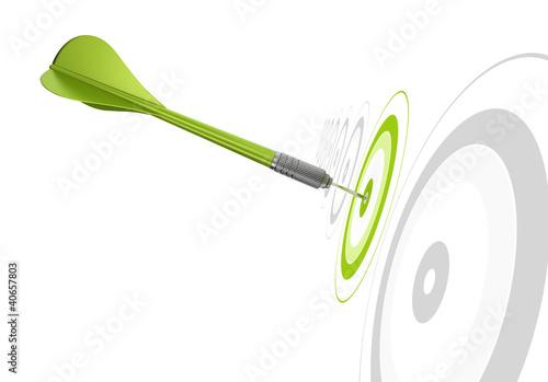green dart hitting the center of a target