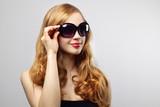 Fashionable lady wearing sunglasses