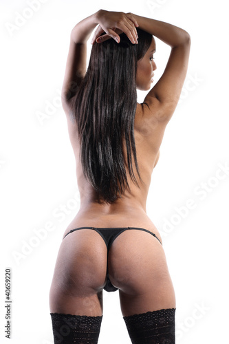 beautiful woman pose shot from behind in lingerie showing her se