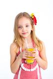 Portrait of little girl drinking orange juice