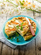 vegetables cake over dish on wood background