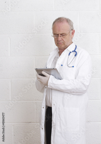 Mature Doctor with his tablet pc