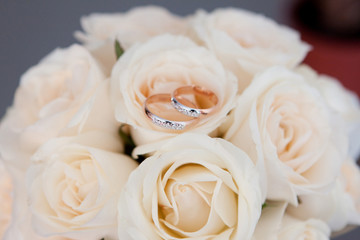 Gold ring on wedding bunch of flowers