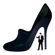 Businessman near the big woman`s shoe