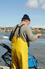 Fisherman tending nets