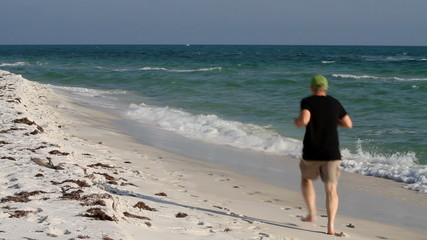 Mature Man Jogging Beach