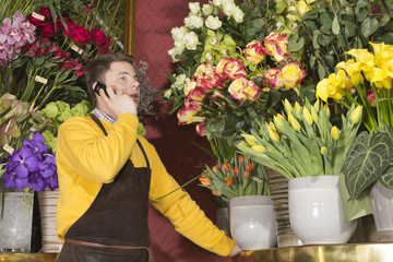 Florist accepting phone order from a customer
