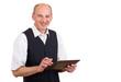 lachender Mann mit Tablet Computer