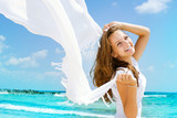 Fototapety Beautiful Girl With White Scarf on The Beach