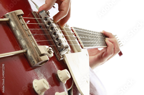 Closeup of a guitarist playing, focus on his hands