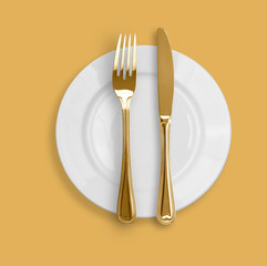 Knife, plate and fork on beige background