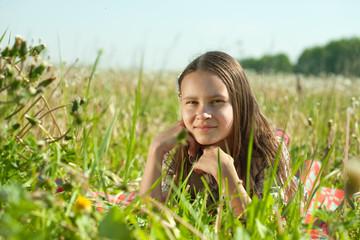 teenager girl lying in meadow