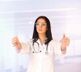 Young doctor wearing white coat and goggles