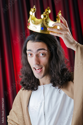King with crown against background