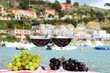 Pair of wineglasses and grapes. Portvenere, Italy