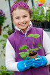 Gardening - lovely girl with strawberry seedling
