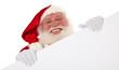 Weihnachtsmann hinter weißem Schild