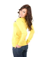 smilimg teenage girl with hands in pocket