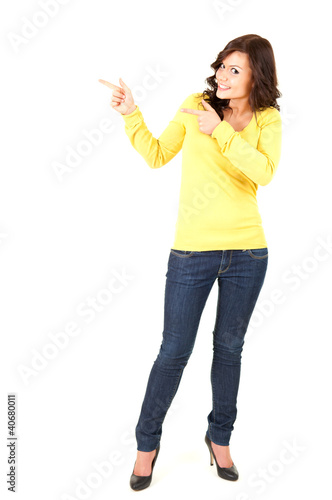 pointing up smiling teenage woman, white background