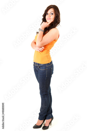 standing thoughtful teenage girl, full length