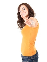 cheerful teenage girl pointing you, white background