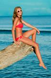 Summer beach - beautiful young girl enjoying the sun poster