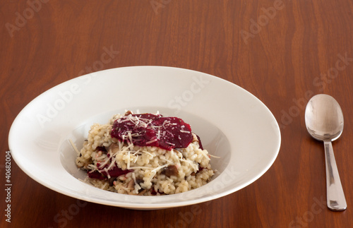 Risotto with cheese and beet