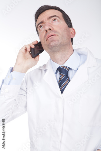 doctor talking on the phone and looking worried