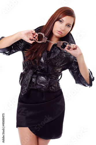 Young woman in black with cuffs