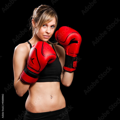 Fitness woman wearing boxing gloves