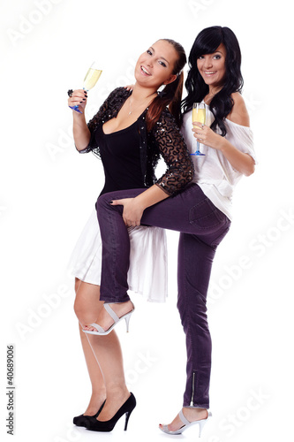 Two young happy women with champagne