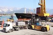 commercial harbor with truck forklift and ship