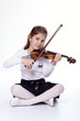 Young girl playing the violin