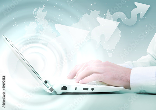 Laptop against technology background
