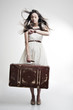 beautiful girl with long  developing hair and  suitcase